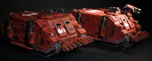 a pair of space marine rhinos